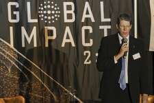 Pastor Darin Wood with First Baptist Church, leads prayers 10/08/18 at the Global Impact 2:2 dinner hosted by 21 Wilberforce, a religious freedom and human rights organization founded by Randel Everett, former pastor of First Baptist Church in Midland Tim Fischer/Reporter-Telegram