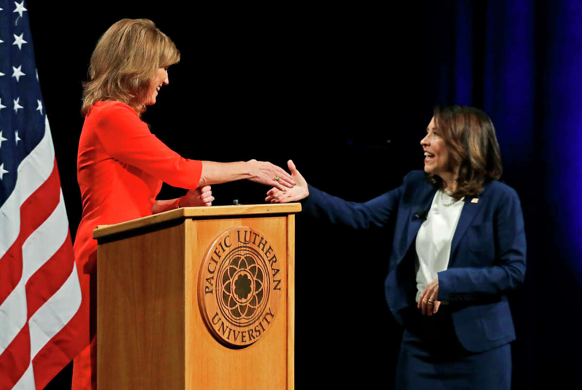 Sen. Maria Cantwell, D-Wash., right, shakes hands with her Republican challenger, Susan Hutchison, left, Monday, Oct. 8, 2018, following a debate at Pacific Lutheran University in Tacoma, Wash. (AP Photo/Ted S. Warren)