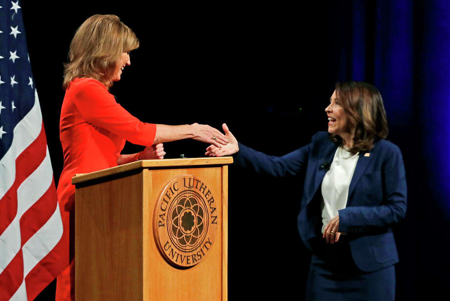 Sen. Maria Cantwell, D-Wash., right, shakes hands with her Republican challenger, Susan Hutchison, left, Monday, Oct. 8, 2018, following a debate at Pacific Lutheran University in Tacoma, Wash. (AP Photo/Ted S. Warren) Photo: Ted S. Warren/AP / Copyright 2018 The Associated Press. All rights reserved.