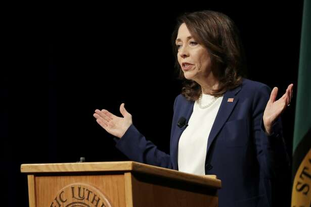 Sen. Maria Cantwell, D-Wash., takes part in a debate with her Republican challenger, Susan Hutchison, Monday, Oct. 8, 2018, at Pacific Lutheran University in Tacoma, Wash. (AP Photo/Ted S. Warren)