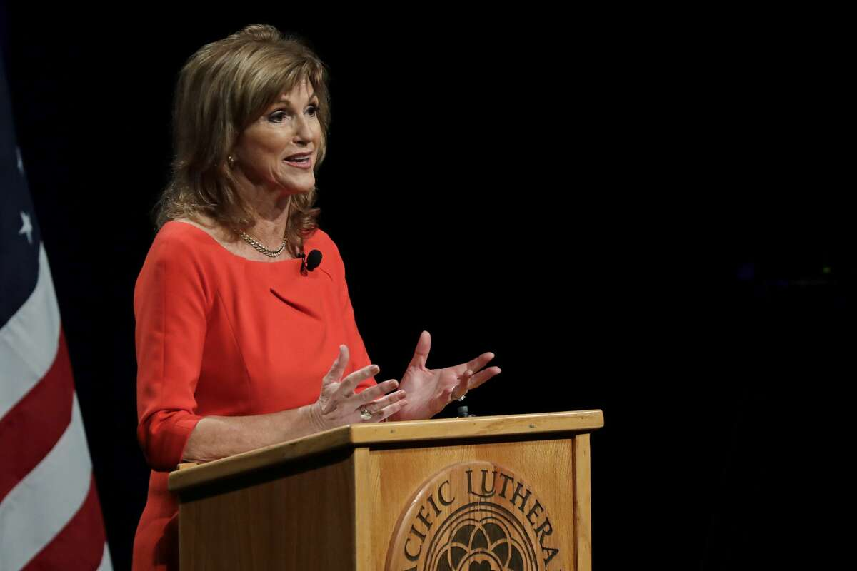 Susan Hutchison, the Republican challenger to Sen. Maria Cantwell, D-Wash., takes part in a debate, Monday, Oct. 8, 2018, at Pacific Lutheran University in Tacoma, Wash. (AP Photo/Ted S. Warren)