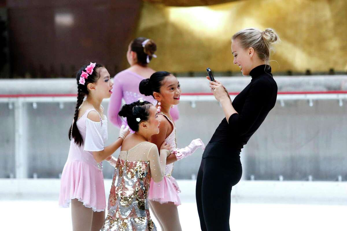 IMAGE DISTRIBUTED FOR PATINA RESTAURANT GROUP/THE RINK AT ROCKEFELLER CENTER - Five-time Finnish national champion figure skater Kiira Korpi hosts a ceremonial first skate marking the 82nd season opening of The Rink at Rockefeller Center, Monday, Oct. 8, 2018 in New York. Korpi was joined on the most famous ice rink in the world by rising youth skaters from Ice Theatre of New York and Figure Skating in Harlem. (Jason DeCrow/AP Images for Patina Restaurant Group/The Rink at Rockefeller Center)