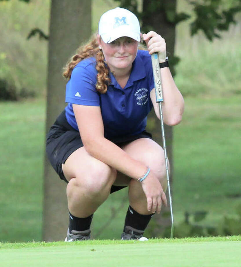 Marquette Catholic freshman Gracie Piar, shown lining up a putt in the regional last week at Okawville, shot 80 to lead the Explorers to a third-place finish and state berth Monday at the Centralia Class 1A Sectional. Photo: Greg Shashack / The Telegraph