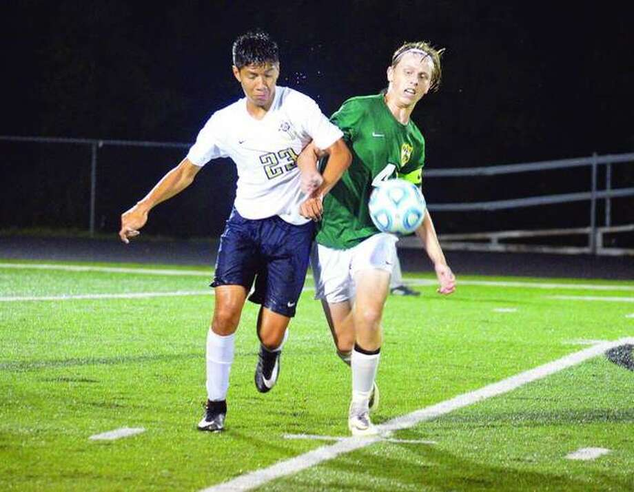 Father McGivney sophomore Diego Pacheco, left, battles for the ball with Metro-East Lutheran's Brent Woolsey on Aug. 20 at Columbia High School in the Puma Bracket of the Metro Cup.