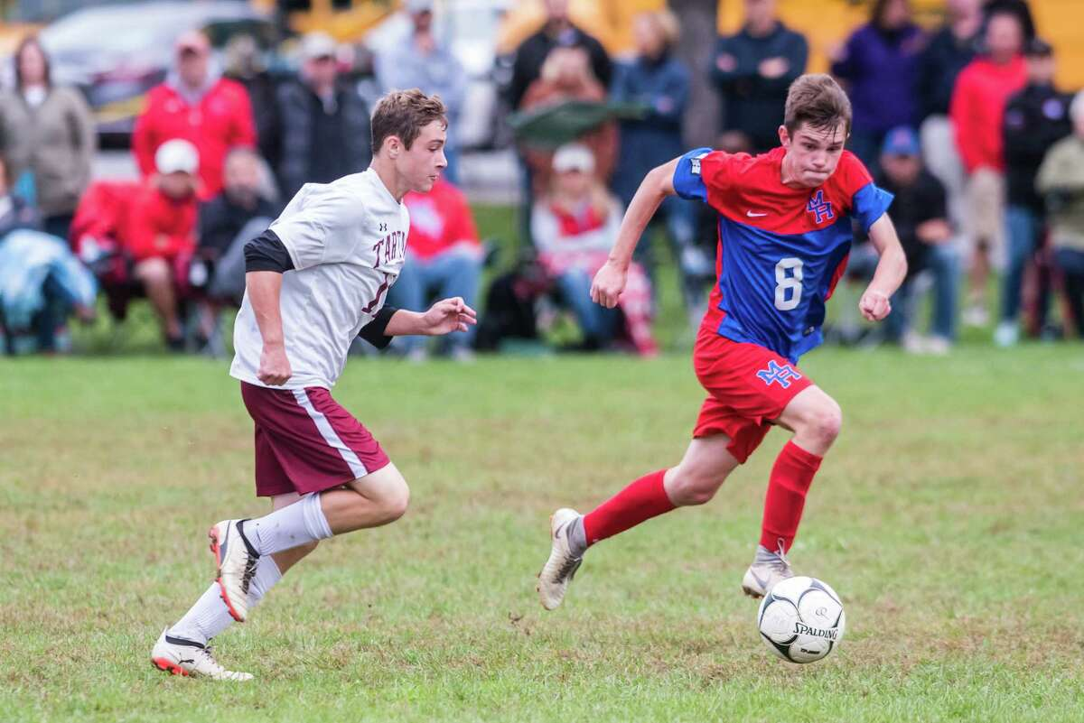 Scotia's Aidan Nichter and Maple Hill's Christian Beber fight for the ball as Maple Hill faced off against Scotia during the Maple Hill Soccer Tournament at Maple Hill in Schodack, NY Monday, October 8th, 2018. Photo by Eric Jenks