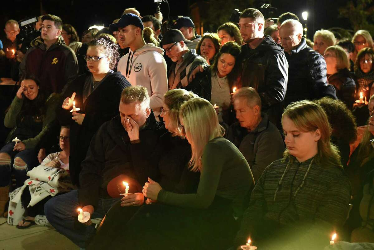 A family member of a victim wipes the tear from another family member during a vigil for the victims of the limousine crash in Schoharie at The Mohawk Valley Gateway Overlook on Monday, Oct. 8, 2018 in Amsterdam, N.Y. (Lori Van Buren/Times Union)