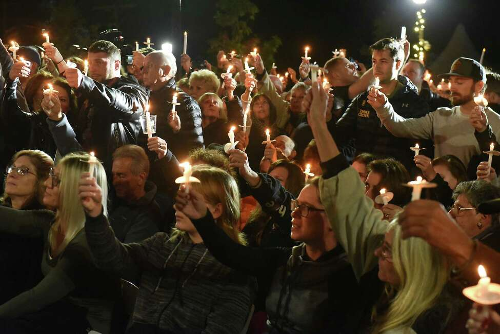 Mourners raise their candle in honor of the victims during a vigil for the victims of the limousine crash in Schoharie at The Mohawk Valley Gateway Overlook on Monday, Oct. 8, 2018 in Amsterdam, N.Y. (Lori Van Buren/Times Union)