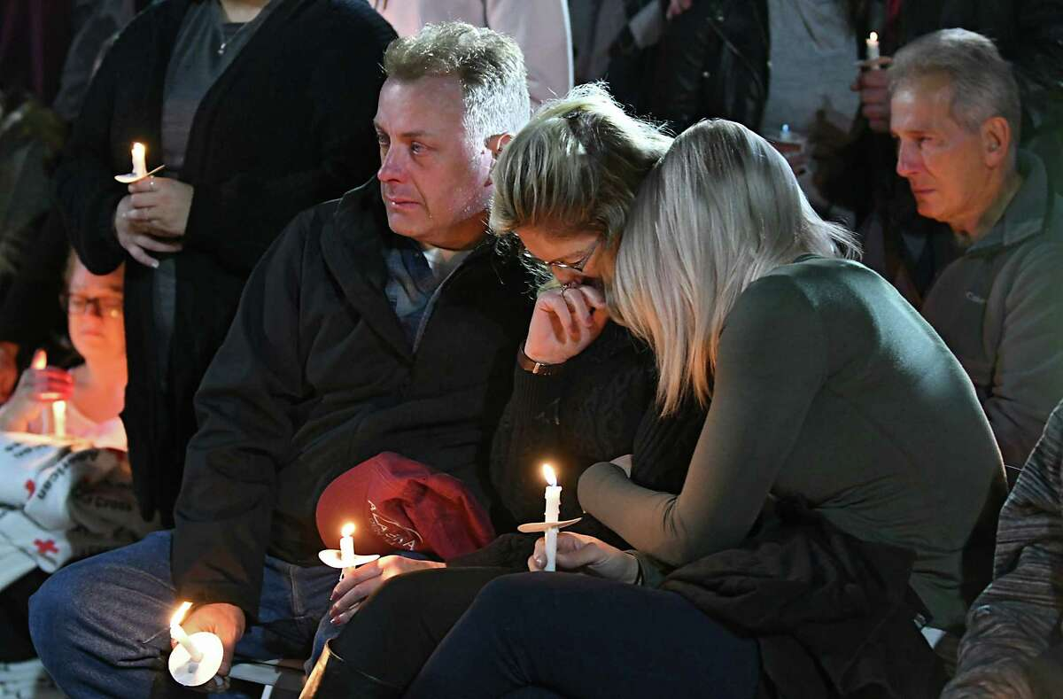 The family of a victim mourns during a vigil for the victims of the limousine crash in Schoharie at The Mohawk Valley Gateway Overlook on Monday, Oct. 8, 2018 in Amsterdam, N.Y. (Lori Van Buren/Times Union)