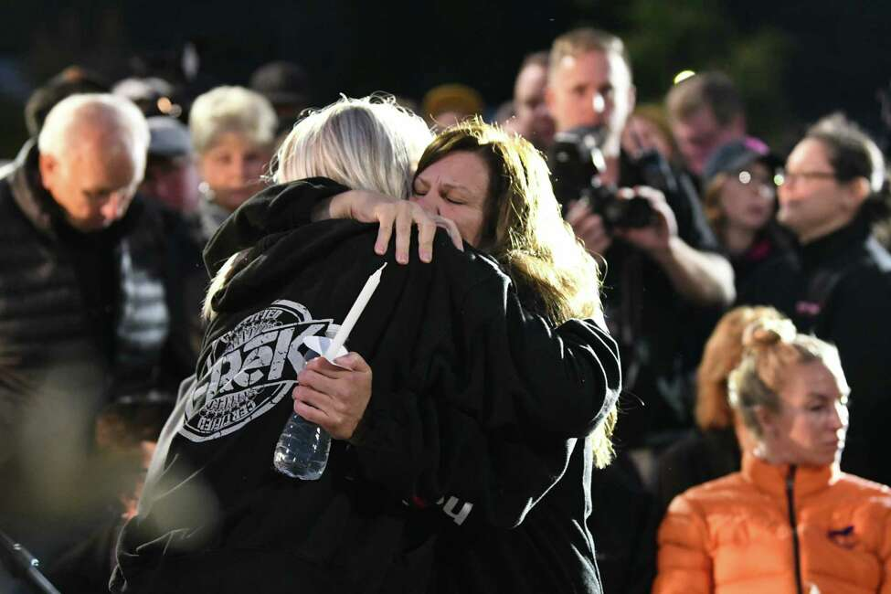 Family and friends hug each other during a vigil for the victims of the limousine crash in Schoharie at The Mohawk Valley Gateway Overlook on Monday, Oct. 8, 2018 in Amsterdam, N.Y. (Lori Van Buren/Times Union)
