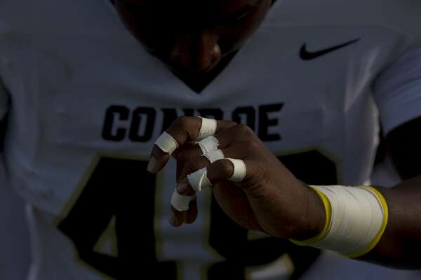 Conroe linebacker Bryce Gordon (48) prays before a non-district high school football game at Legacy Stadium on Saturday, Sept. 1, 2018, in Katy. Conroe defeated Mayde Creek 37-22.