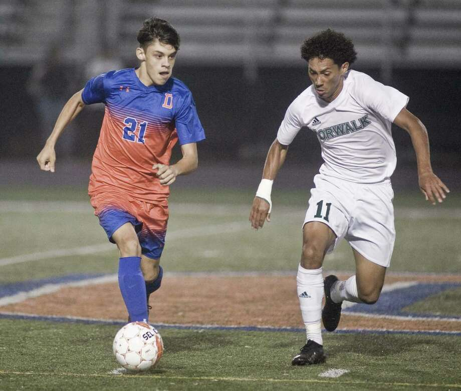 Danbury's Lucas Oliveira tries to keep the ball ahead of Norwalk's Michael Hidalgo in Monday's 0-0 tie in Danbury. Photo: Scott Mullin / For Hearst Connecticut Media / The News-Times Freelance