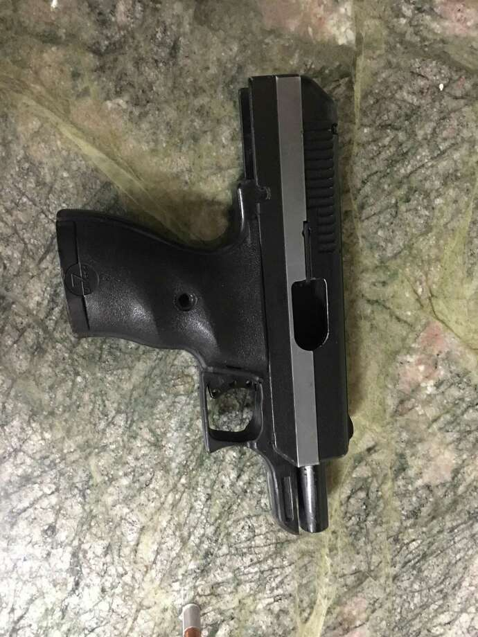 Bridgeport police recovered this Hi-Point .380 acp during a motor vehicle stop near the Green Homes Tuesday. The gun was reported stolen in South Carolina in 2017. A single round was also seized. Two men and two juvenile females are under arrest. Photo: / Bridgeport Police