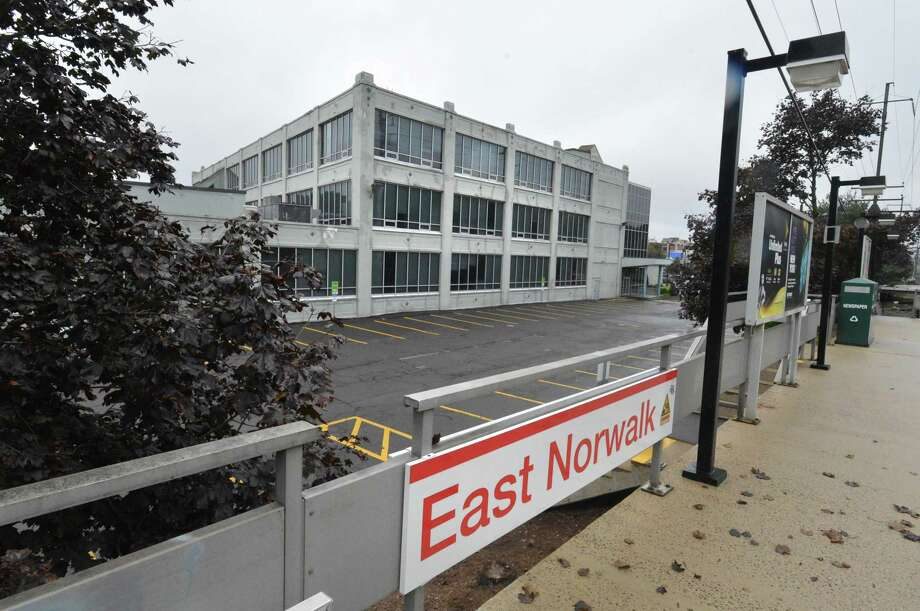 The building at 230 East Ave, stands next to the East Norwalk train station on Monday. Plans have been approved for a 189-unit Transit Oriented Development. Photo: Alex Von Kleydorff / Hearst Connecticut Media / Norwalk Hour