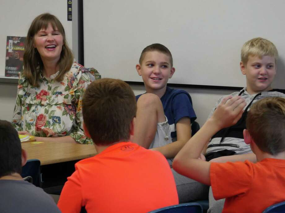 Friendswood Junior High School language arts teacher Autumn Bockart laughs with students Aiden Collins, left, Fletcher Weston, Bradley Furman, Caiden Sullivan and Tucker Jarvis during a social/emotional learning session.