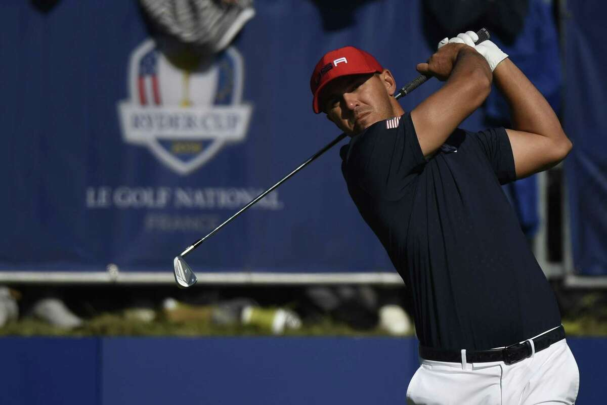 US golfer Brooks Koepka plays a tee shot during his singles match with Europe's English golfer Paul Casey on the third day of the 42nd Ryder Cup at Le Golf National Course at Saint-Quentin-en-Yvelines, south-west of Paris, on September 30, 2018. (Photo by Eric FEFERBERG / AFP)ERIC FEFERBERG/AFP/Getty Images