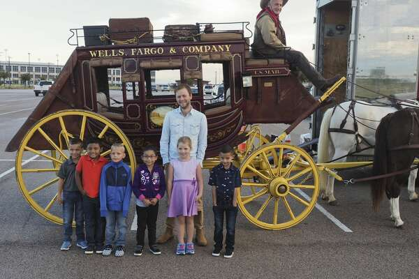 Author Marc Barnett meets with students from Yarbrough Elementary 10/09/18 as they prepare to get a ride on the Wells Fargo stagecoach for Project Literacy. Tim Fischer/Reporter-Telegram