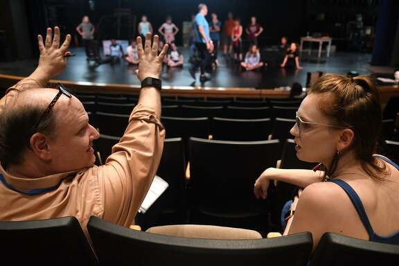 "Director Michael Montgomery, of Cypress, left, and Courtney Berry, 26, of Spring, who is playing the part of the ""Ghost of Christmas Past"" in the upcoming Stageworks Theatre production of ""A Christmas Carol"", chat off stage during a rehearsal at The Lone Star College - Cy-Fair Performing Arts Center on Sept. 26, 2018."