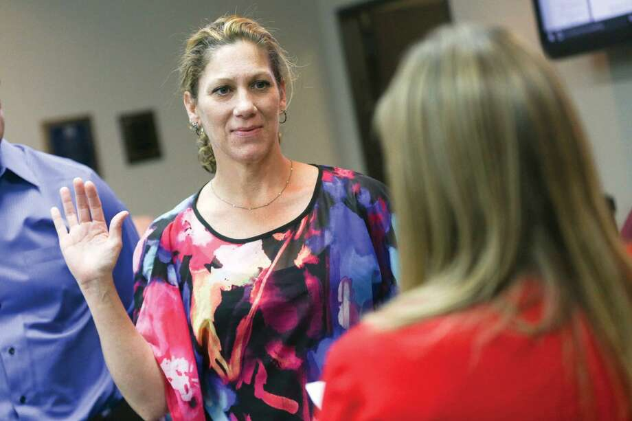 Michelle Cassio, Council Member Place 4, takes the oath of office during the ceremony in 2016, at Oak Ridge North City Hall. Cassio announced her resignation to city council after their Sept. 24 meeting and is expected to be replaced with local business owner Dawn Candy. Photo: Michael Minasi, Photographer