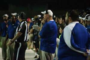 Friendswood football coach Robert Koopmann (center) hopes his team can win its sixth straight game when the Mustangs host Richmond Foster Friday.