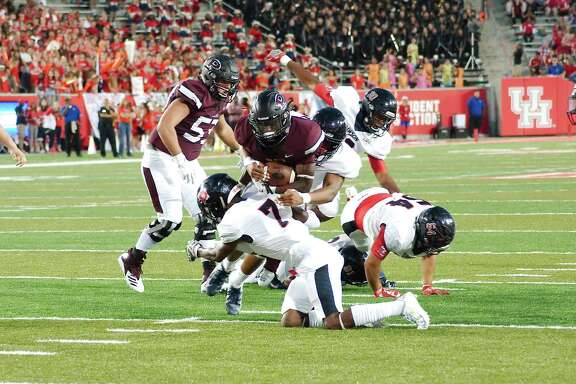 Pearland's Jaelin Benefield (2) tries to muscles his way toward the end zone Friday at the University of Houston.