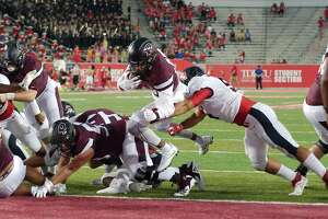 Pearland and Dawson, shown playing last year at the University of Houston, host scrimmages this week at Pearland Stadium. The Oilers test Westfield at 7 p.m., Thursday while the Eagles take on Clear Brook at 7 p.m., Friday.