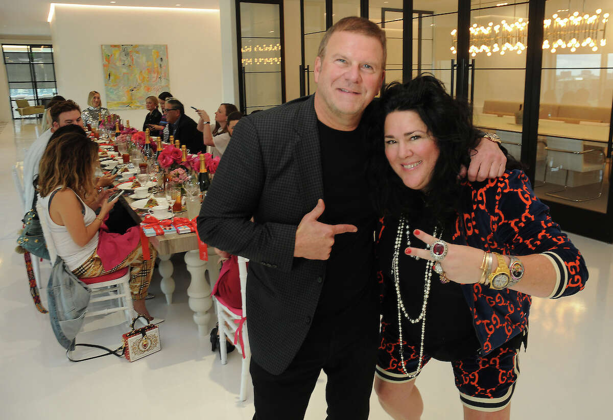 Tilman Fertitta and Ashley Longshore at a media luncheon at the new offices of DPWPR in The Post Oak Thursday Oct. 04,2018.