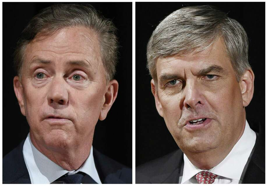 FILE - This pair of Sept. 26, 2018 file photos shows Democrat Party gubernatorial candidate Ned Lamont, left, and Republican Party gubernatorial candidate Bob Stefanowski after a debate at the University of Connecticut in Storrs, Conn. The two men will face off in the November general election. (AP Photo/Jessica Hill, File) Photo: Jessica Hill / Associated Press / Copyright 2018 The Associated Press. All rights reserved