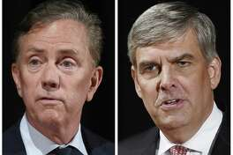 FILE - This pair of Sept. 26, 2018 file photos shows Democrat Party gubernatorial candidate Ned Lamont, left, and Republican Party gubernatorial candidate Bob Stefanowski after a debate at the University of Connecticut in Storrs, Conn. The two men will face off in the November general election. (AP Photo/Jessica Hill, File)