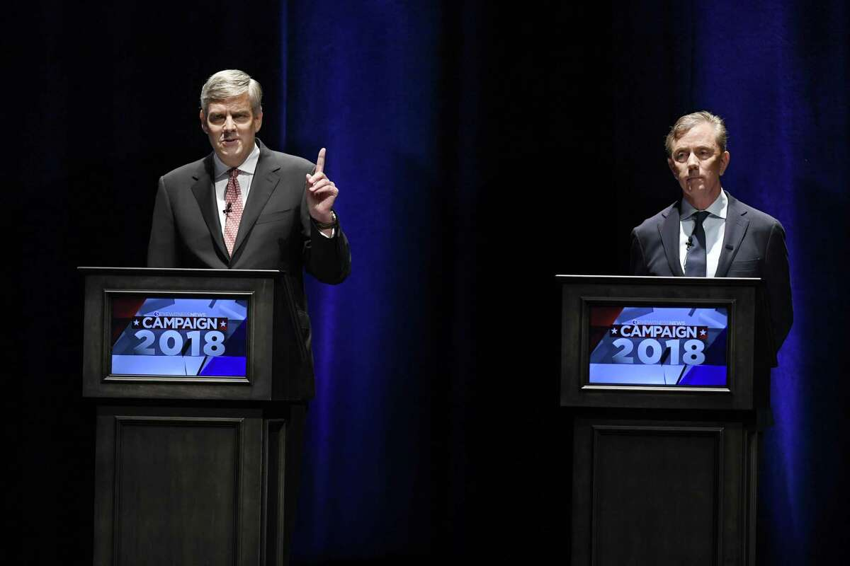 Republican Party candidate Bob Stefanowski, left, gestures as he speaks while Democratic Party candidate Ned Lamont, right, listens during a gubernatorial debate at the University of Connecticut in Storrs, Conn., Wednesday, Sept. 26, 2018. (AP Photo/Jessica Hill)