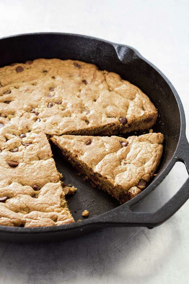 Chocolate chip skillet cookie, top with ice cream for an extra-decadent treat. Photo: Photo Courtesy Of America's Test Kitchen / / 2015, Boston Common Press, DBA America's Test Kitchen. All Rights Reserved.