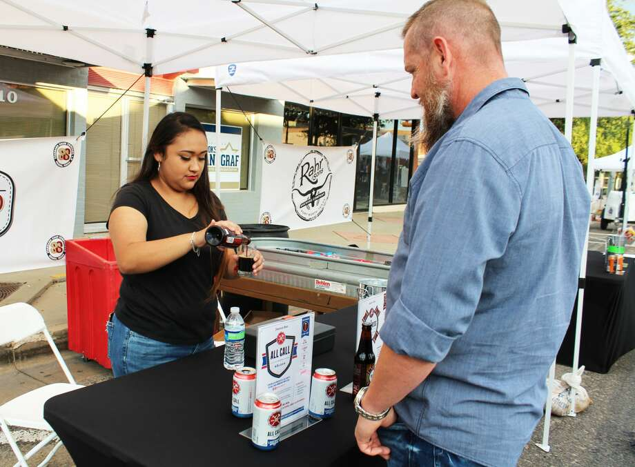 Downtown Odessa, Inc.'s third annual fundraiser Tap into Downtown Odessa was Saturday. The craft beer and wine tasting festival featured fall-themed tastings, live music and food truck vendors. Photo: Tori Aldana