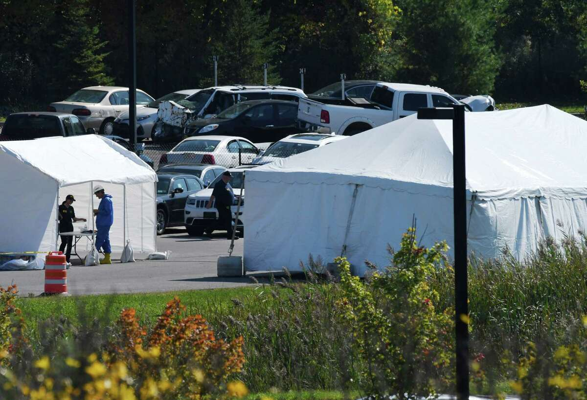 National Transportation Safety Board investigators and state police are examining the limousine that took the lives of 20 in Saturday's fatal crash in Schoharie County, as they search for answers under the cover of a tent, right, at State Police Troop G Headquarters on Tuesday, Oct. 9, 2018, in Latham, N.Y. (Will Waldron/Times Union)