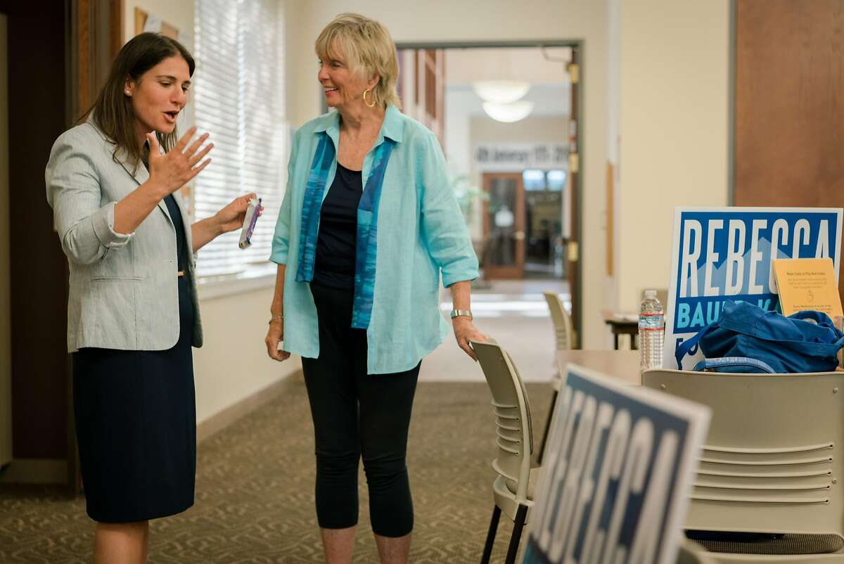 (Left) Rebecca Bauer-Kahan talks with Sheilah Fish of Moraga, at a phone bank in Walnut Creek, Calif., on Wednesday, September 26, 2018.