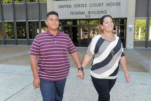 Jose Martinez and his mother, Jessica Martinez, lead plaintiff in Martinez vs. Malloy, pose for a photo outside U.S. District Court in Bridgeport on Aug. 24.