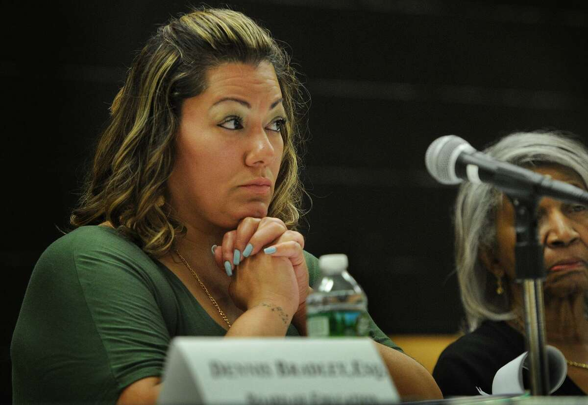 Bridgeport Board of Education member Jessica Martinez listens to speakers at a public hearing over proposed budget cuts at Geraldine Johnson School in Bridgeport, Conn. on Monday, April 30, 2018.