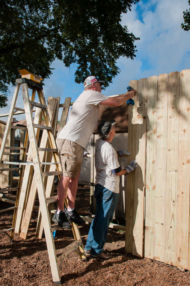 Around 150 volunteers from the AEC Cares ProjectHouston came out Friday, Oct. 5, to the Santa Maria Hostel in Spring Branch to make improvements to the facility that provides residential addiction treatment and housing to approximately 110 women each day. Here, volunteers work on the outdoor space. Photo: Courtesy Photo By Sheryl Lochridge With Your Best Shot Photography