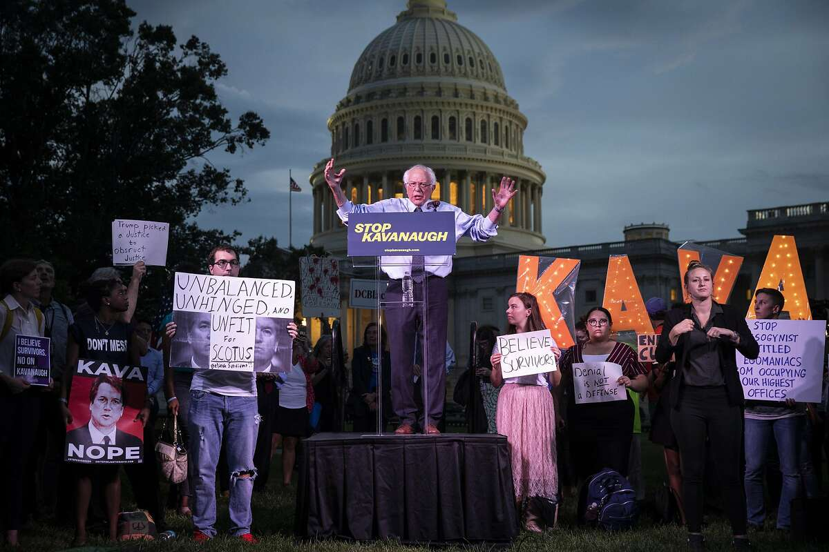WASHINGTON, DC - OCTOBER 4: U.S. Sen. Bernie Sanders (I-VT) speaks to protestors rallying against Supreme Court nominee Judge Brett Kavanaugh on Capitol Hill, October 4, 2018 in Washington, DC. Kavanaugh's confirmation process was halted for less than a week so that FBI investigators could look into allegations by Dr. Christine Blasey Ford, a California professor who who has accused Kavanaugh of sexually assaulting her during a party in 1982 when they were high school students in suburban Maryland. (Photo by Drew Angerer/Getty Images)