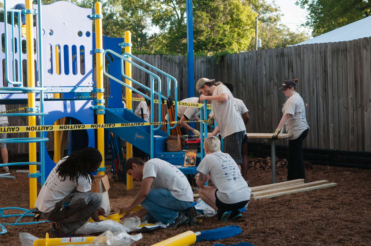 Children of women participating in programs at the Santa Maria Hostel in Spring Branch can now enjoy a new playground thanks to the Friday, Oct. 5, work of about 150 volunteers from AEC Cares Project Houston. The nonprofit Santa Maria facility strives to improve the lives of women facing substance use issues and their families.