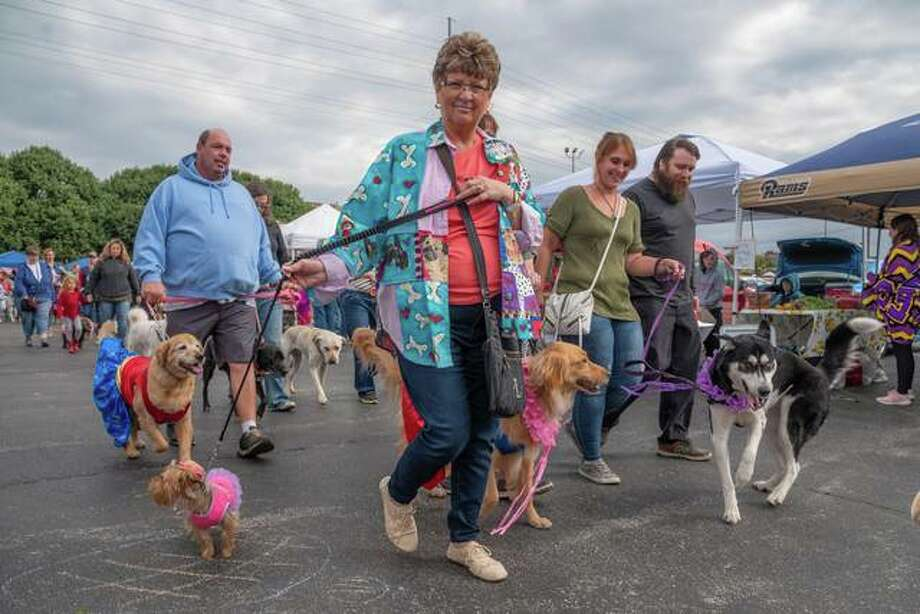 Dogs and their owners enjoyed the recent SNIP Alliance's Canine Carnival at the Alton Farmers' and Artisans' Market. Photo: For The Telegraph