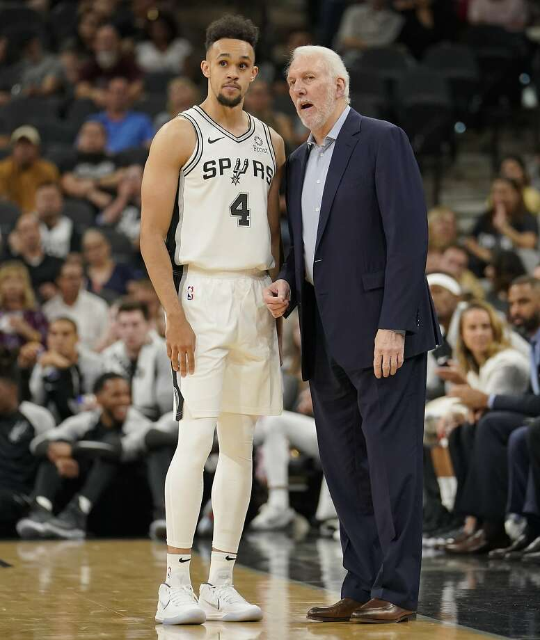 San Antonio Spurs head coach Gregg Popovich, right, talks to Spurs guard Derrick White during the first half of an NBA preseason basketball game against the Miami Heat, Sunday, Sept. 30, 2018, in San Antonio. San Antonio won 104-100. (AP Photo/Darren Abate) Photo: Darren Abate, Associated Press
