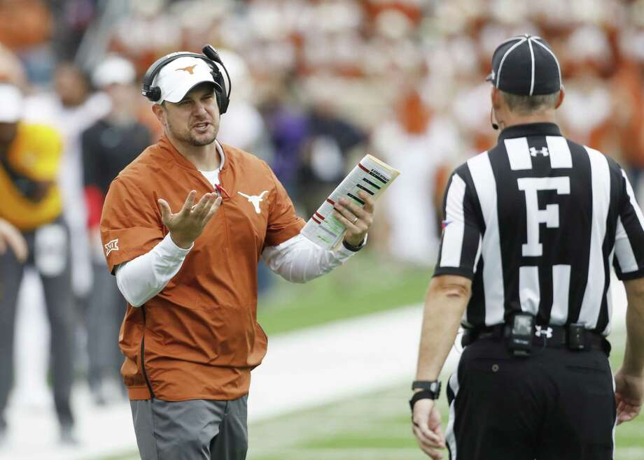 Texas head coach Tom Herman talks with a referee during a college football game against Kansas State in Manhattan, Kan., Saturday, Sept. 29, 2018. Photo: Colin E. Braley, FRE / Associated Press / Copyright 2018, The Associated Press