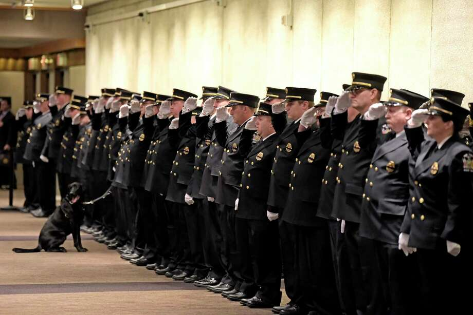 Firefighters salute during the New York State Fallen Firefighters Memorial Service on Tuesday, Oct. 9, 2018, in Albany, N.Y. This year the names of 28 firefighters who gave their lives in the line of duty were added to the wall.  (Paul Buckowski/Times Union) Photo: Paul Buckowski, Albany Times Union / (Paul Buckowski/Times Union)