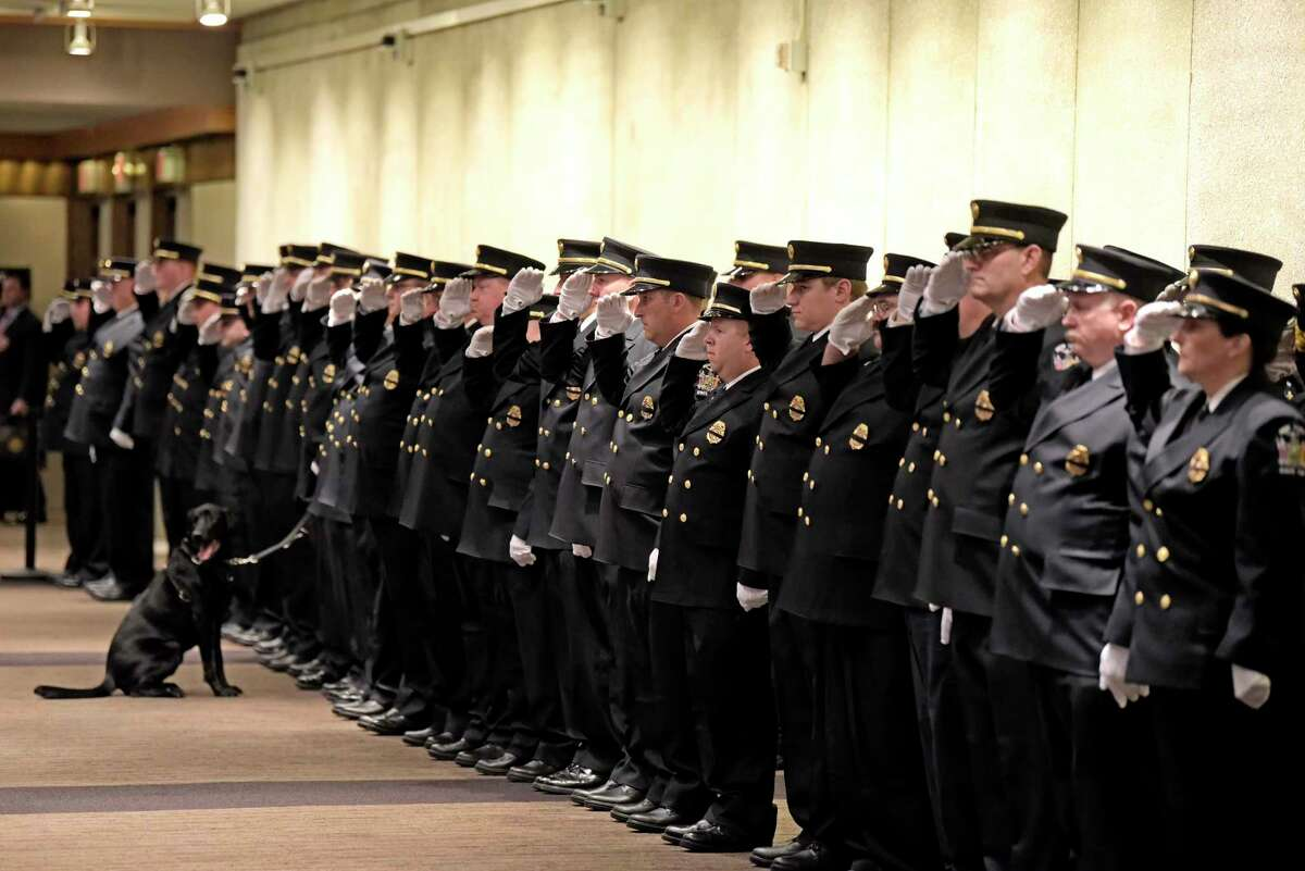 Firefighters salute during the New York State Fallen Firefighters Memorial Service on Tuesday, Oct. 9, 2018, in Albany, N.Y. This year the names of 28 firefighters who gave their lives in the line of duty were added to the wall. (Paul Buckowski/Times Union)