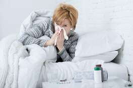 The influenza virus hijacks human cells in the nose and throat to make copies of itself. (Dreamstime)