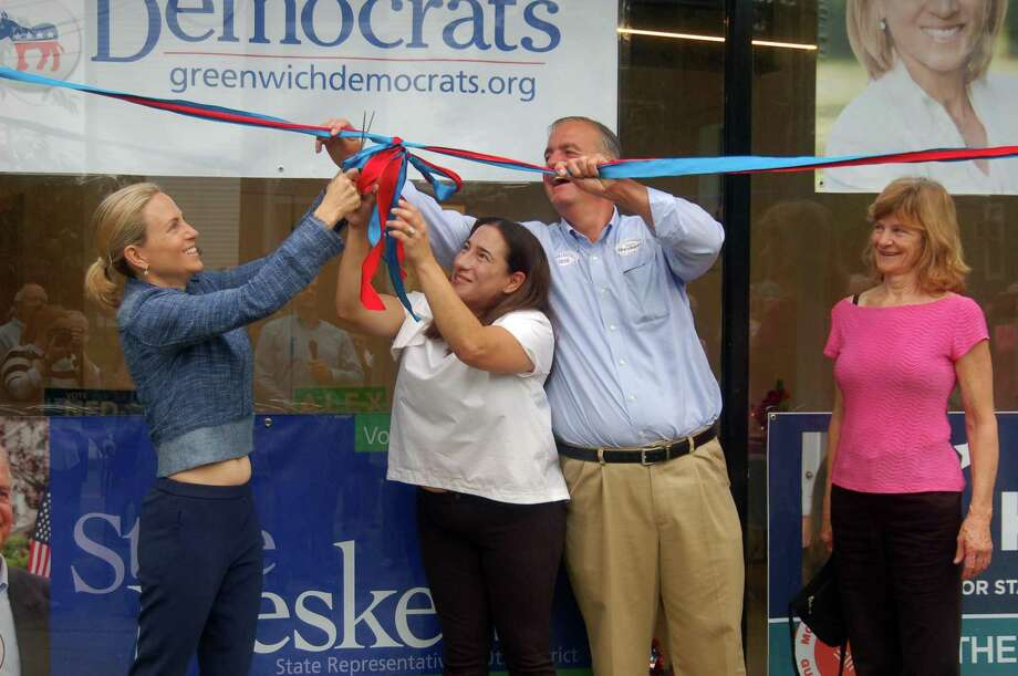 The Democratic Town Committee celebrated Monday morning at the opening of its new headquarters on Field Point Road. State senate candidate Alexandra Bergstein and state representative candidates Laura Kostin and Stephen Meskers cut the ribbon as DTC secretary Phyllis Behlen, far right, looked on. Photo: Ken Borsuk / Hearst Connecticut Media / Greenwich Time