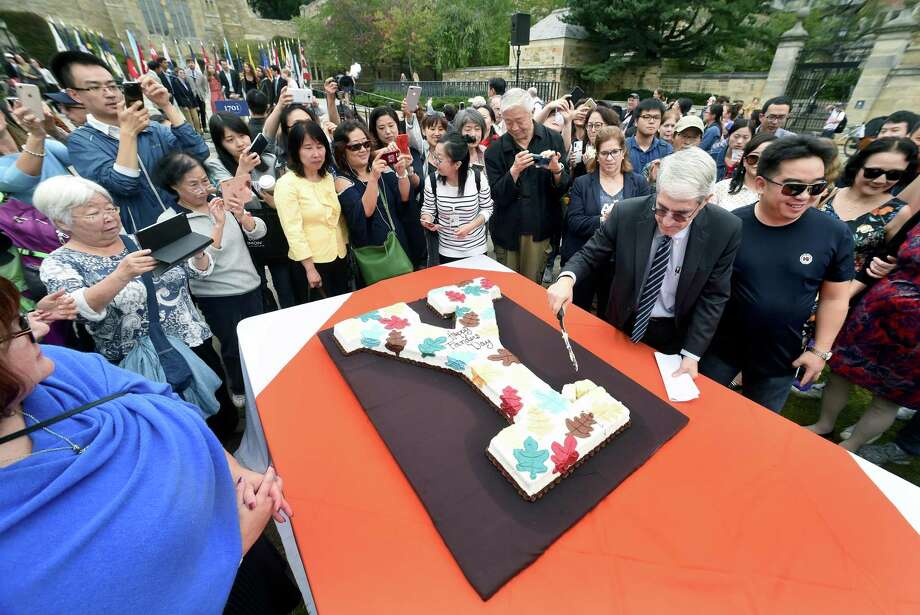 Yale University President Peter Salovey cuts a cake on Cross Campus in New Haven Tuesday during the fifth annual Founders Day, celebrating the founding of the university in 1701. Photo: Arnold Gold / Hearst Connecticut Media / New Haven Register