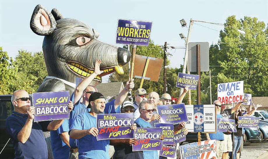 Members of the International Association of Machinists District 9 held a small rally and informational picket Tuesday morning outside the Wood River Township Assessor's Office at the top of Ninth Street hill in East Alton. Photo: John Badman | The Telegraph