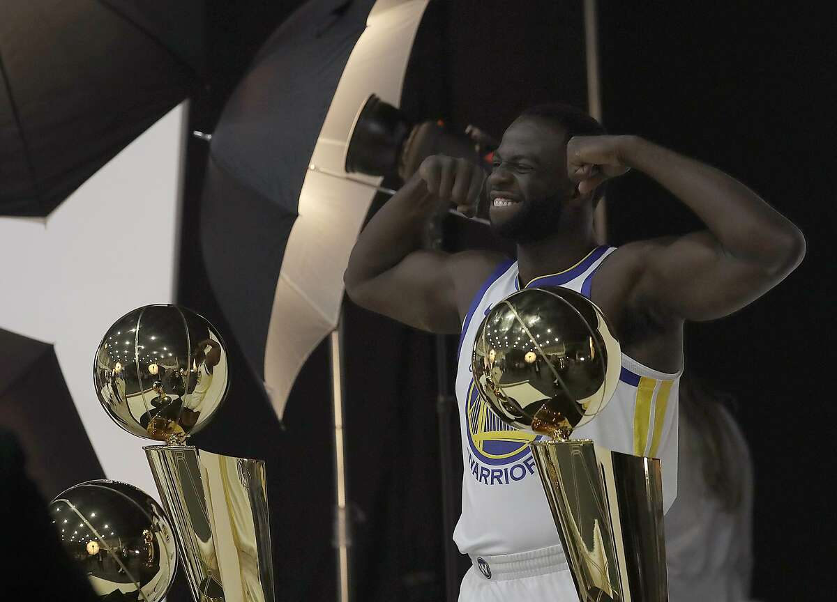 Golden State Warriors' Draymond Green poses for photos during media day at the NBA basketball team's practice facility in Oakland, Calif., Monday, Sept. 24, 2018. (AP Photo/Jeff Chiu)