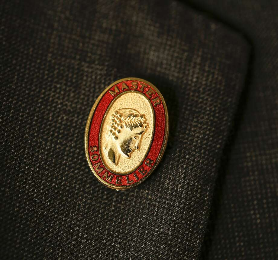 The small red pin is the master sommelier's badge of honor. Photo: Russell Yip / The Chronicle