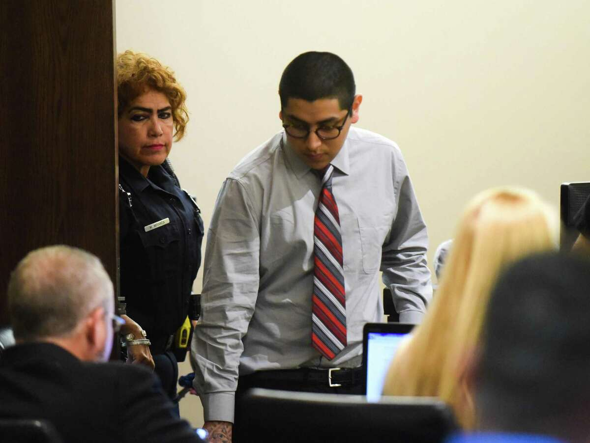 Jonathan Perales, who is accused of the capital murder death of Michael Clayton Robinson, who was a physician's assistant in Universal City, enters the courtroom of Judge Melisa Skinner on Tuesday, Oct. 9, 2018.